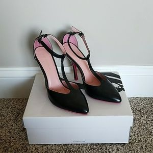 Black high heels with pink bottoms